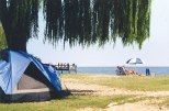 Breezy Point Beach and Campground features a half mile of sandy beach, a 300-foot fishing and crabbing pier, a netted swimming area, playground, bath houses, picnic areas, volleyball courts and more.