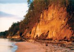Early morning light casts a golden glow onto the cliffs.
