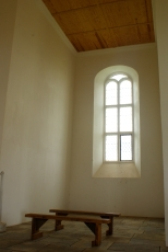 Light shines through the windows of the reconstructed Chapel of 1667.