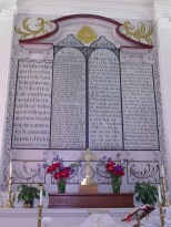 A close-up of the decorative panels of the Ten Commandments and the Lord's Prayer behind the altar inside St. Andrew's Episcopal Church in Hollywood, St. Mary's County, MD.